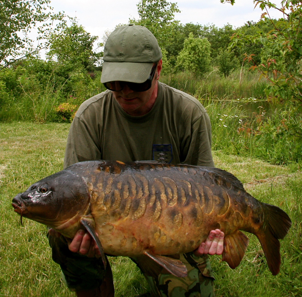 Can you believe it, this 30lb Carp is regarded by some as the best looking fish in the UK, yet Holmesy was disappointed with it at the time as it was not intended to take the bait. How bizarre is that?