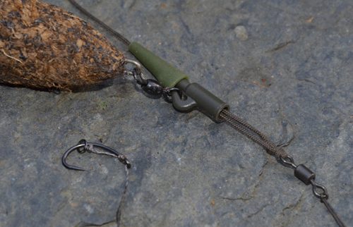 "The hook link swivel is attached ""loop to loop"" fashion when using a lead clip."