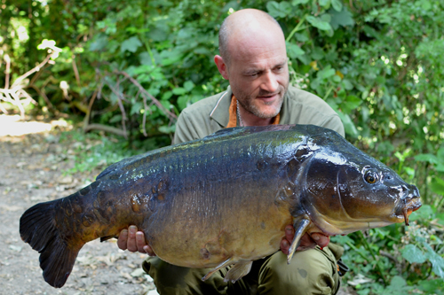 A 35lb 11oz mirror caught the morning after a few hours raking a spot in an otherwise unfishable swim